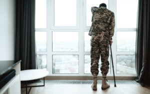 injured veteran looking out the window